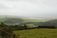 [Looking along the Chesil beach from the hills behind the fleet]